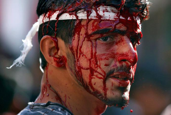 A Kashmiri Shiite Muslim bleeds after he flagellated himself during a Muharram procession to mark A