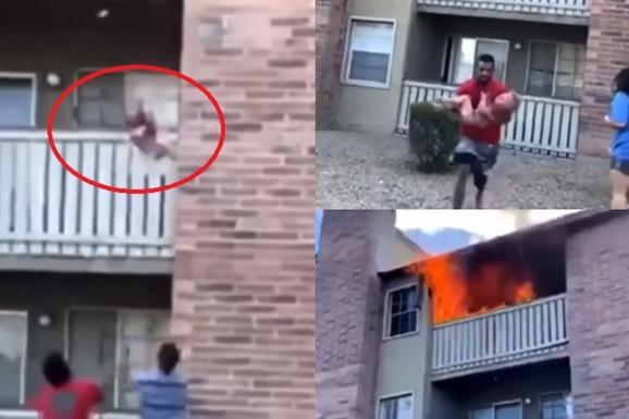 NJEGA SLAVI ČITAVA AMERIKA, POSLE VELIKE DRAME! Fudbaler uhvatio dečaka, nakon što ga je majka bacila iz zgrade koju je GUTAO požar! /VIDEO/