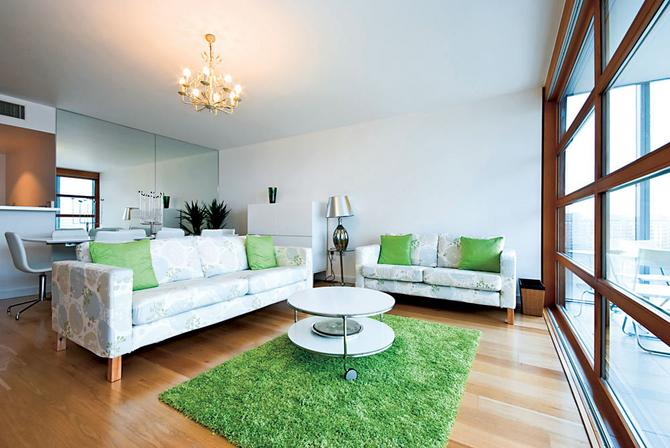 17062_stock-photo-contemporary-living-area-with-designer-furniture-with-green-fragments-and-floor-to-ceiling-windows-shutterstock_50434069