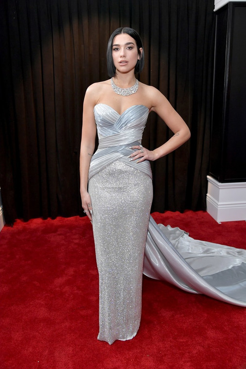 Dua Lipa look stunning in a silver strapless column gown