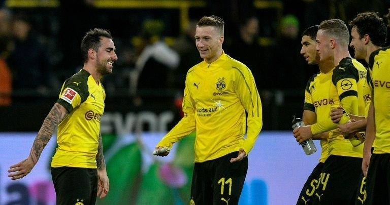 Dortmund striker Alcacer Paco (L) and captain Marco Reus (C) celebrate after the Spaniard became the league's top-scorer in last weekend's 2-0 win at home to Freiburg when the Spaniard hit his 10th goal - nine of which have come off the bench.