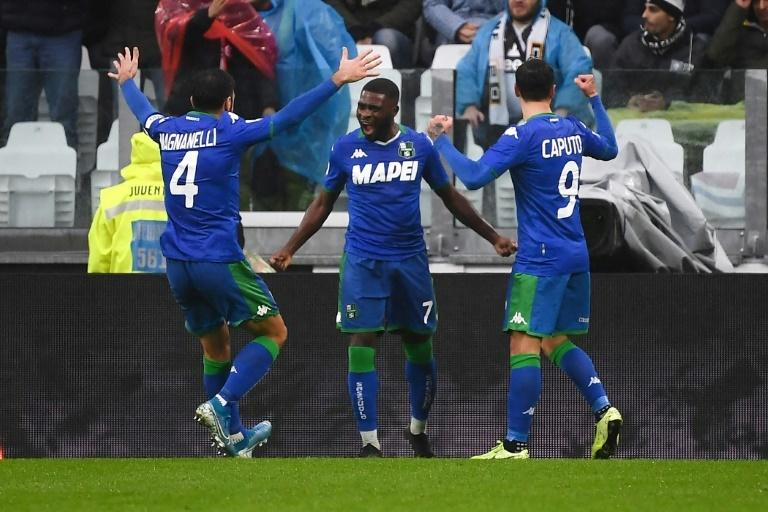 Ivorian forward Jeremie Boga (C) celebrates scoring Sassuolo's opening goal in a battling 2-2 draw against Juventus