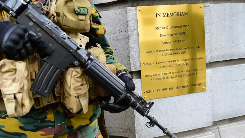A Belgium soldier stands guard in front the entrance of the Jewish Museum of Belgium, beside a memorial plate to the victims of a shooting terrorist attack, in Brussels, on May 19, 2015