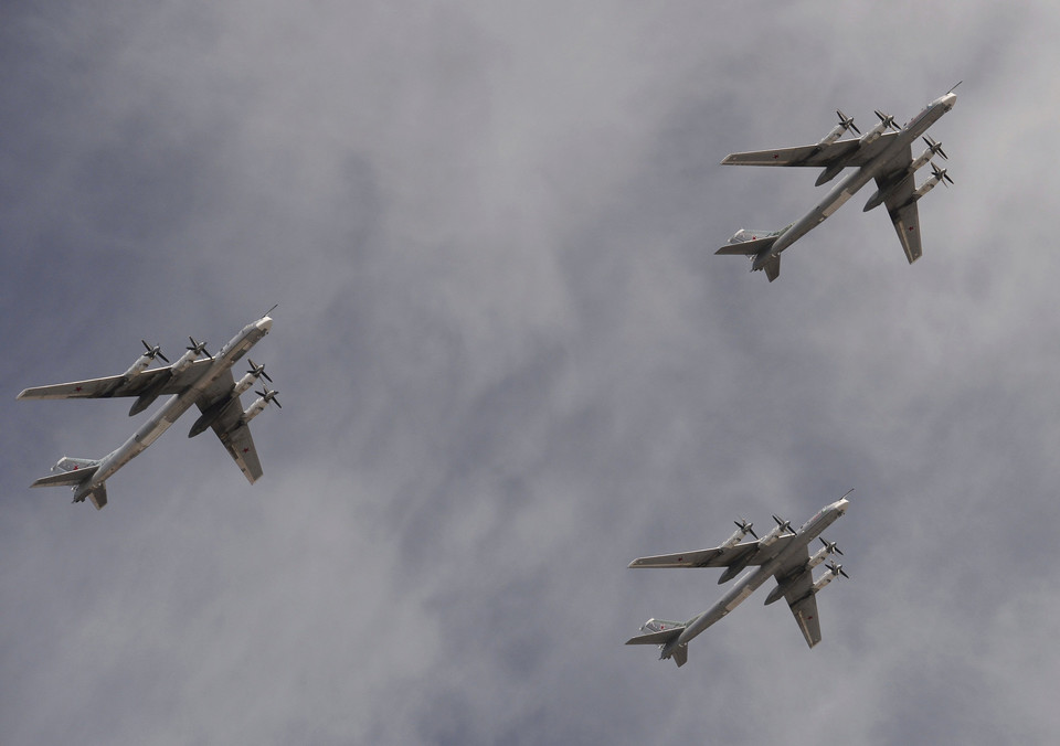 Tupolev Tu-95MS Bear strategic bombers fly in formation over the Red Square during the Victory Day parade in Moscow