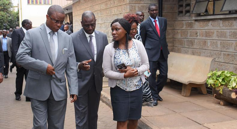 Edwin Abonyo, husband to Dr Joyce Laboso, with DP William Ruto at Lee funeral home