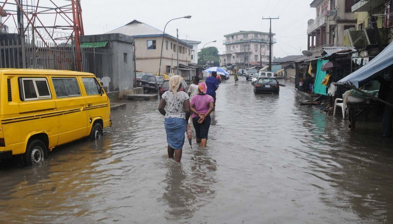 Residents trudge in flood water in Lagos (Illustrative. Punch)