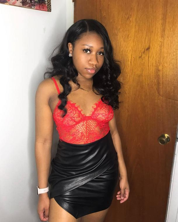Red bodysuit paired with a black faux leather skirt (Instagram amariaruthh) ec282d04c