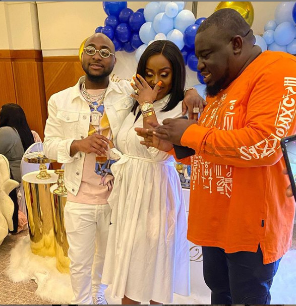 Davido, Chioma and a guest at the naming ceremony in London.