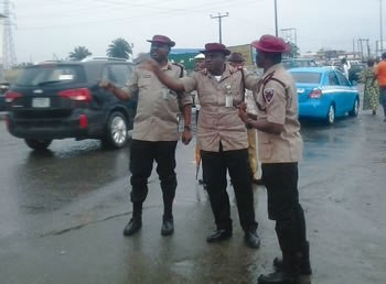 Mr. Imoh Etuk (middle) and two other FRSC officials