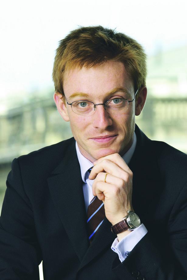 Julien Hollier, Avocat a la Cour - adwokat, z Kancelarii Prawnej GLN