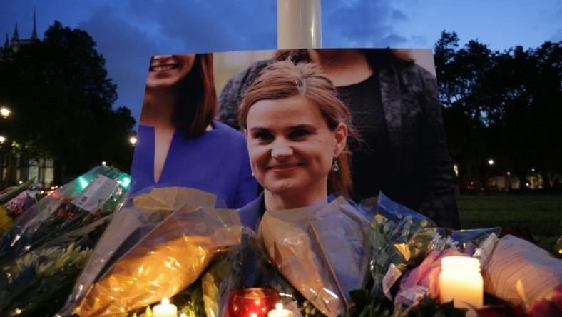 Floral tributes and candles are placed by a picture of slain Labour MP Jo Cox at a vigil in Parliament square in London on June 16, 2016