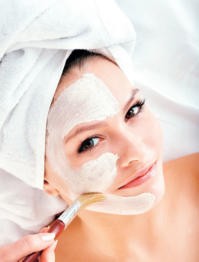 12771_stock-photo-young-woman-with-clay-facial-mask-shutterstock_60488761