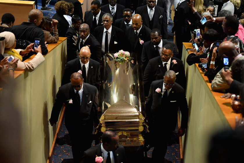Flowers are seen on the casket of the late singer Aretha Franklin as it is laid to rest at her buria