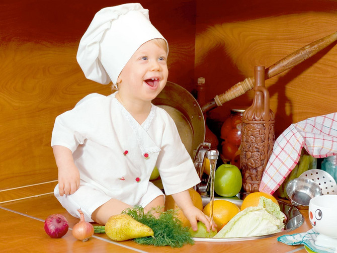 22468_stock-photo-laughing-little-boy-in-the-cook-costume-at-the-kitchen-with-vegetables-shutterstock_2384821