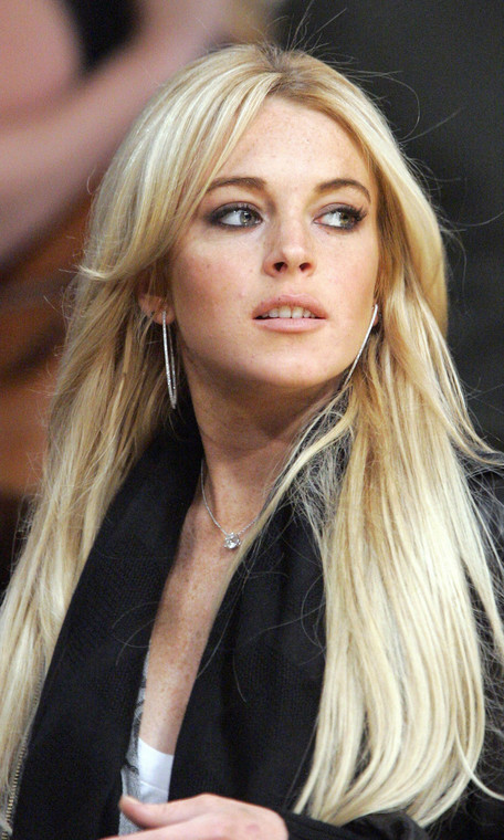 ** FILE ** Actress Lindsay Lohan is seen at the Los Angeles Lakers game against the Orlando Magic, in this Dec. 2, 2007, file photo in Los Angeles. Sales of Britney Spears-related eBay items topped those for Paris Hilton and Lindsay Lohan in 2007, according to the popular online auction site. There were 34,345 Spears-related items sold this year  while 27,377 items associated with Hilton were purchased. Lohan's name was only associated with 8,099 items sold. (AP Photo/Mark J. Terrill, file)