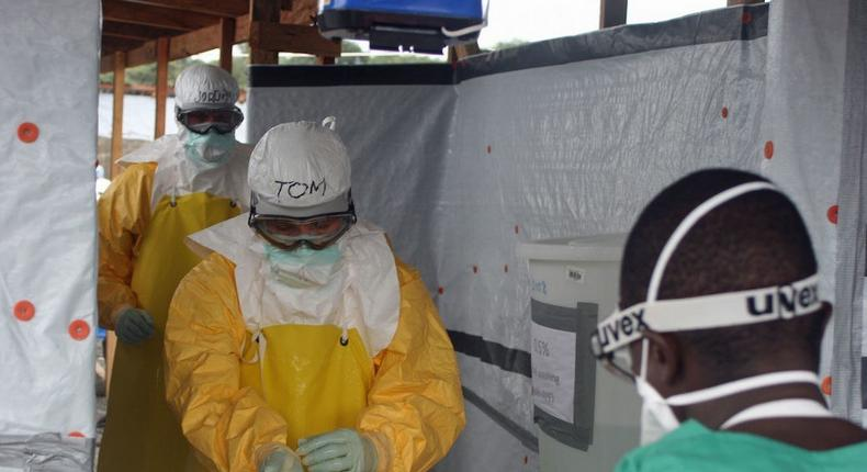 CDC Director Dr. Tom Friedenexits an Ebola treatment unit in West Africa in 2014.
