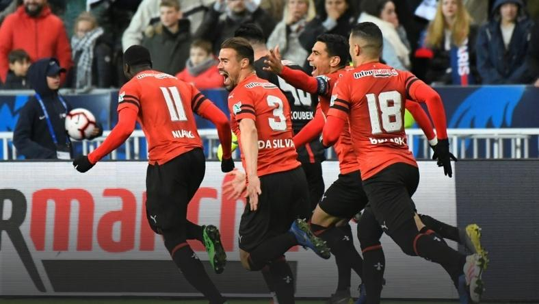 Rennes players celebrate after winning the French Cup final on penalties against PSG