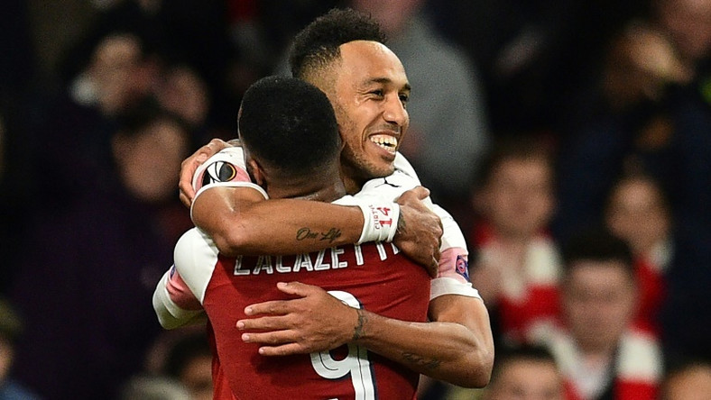 Pierre-Emerick Aubameyang celebrates with Alexandre Lacazette after scoring against Valencia in the semi-finals
