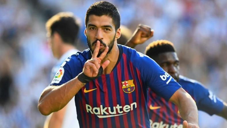 Luis Suarez scored the first of Barcelona's two goals in three minutes