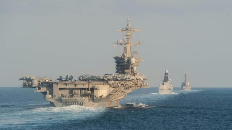 The aircraft carrier USS Abraham Lincoln and its strike group travelled through the Strait of Hormuz this week, a first for a US carrier since April