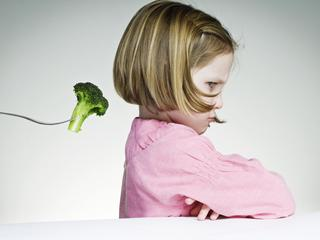 Young Girl Refusing To Eat Her Greens