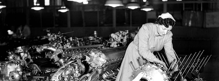 World War Two. 1942. England. A woman at work during the war making Rolls Royce Merlin aircraft engi