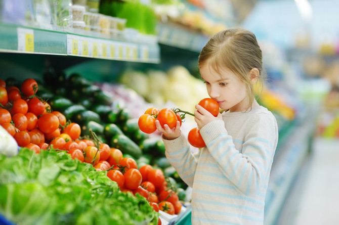 stock-photo-little-girl-choosing-tomatoes-in-a-food-store-or-a-supermarket-298593938