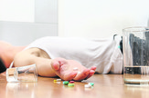 stock-photo-overdose-close-up-of-pills-and-addict-lying-on-the-floor-health-concept-548482309