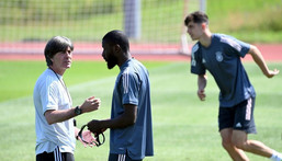 Germany coach Joachim Loew with defender Antonio Ruediger at a training session on Friday ahead of their game against Portugal Creator: CHRISTOF STACHE