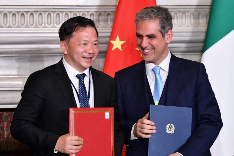 China's Media Group head Shen Haixiong (L) and the president of Italy's national public broadcasting company RAI, Marcello Foa pose during a signing ceremony of partnership agreements.