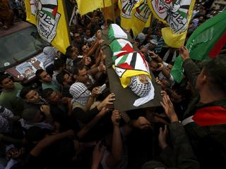 Mourners carry the body of 13-year-old Palestinian boy Abdel-Rahman Abeidallah, who was shot by Isra