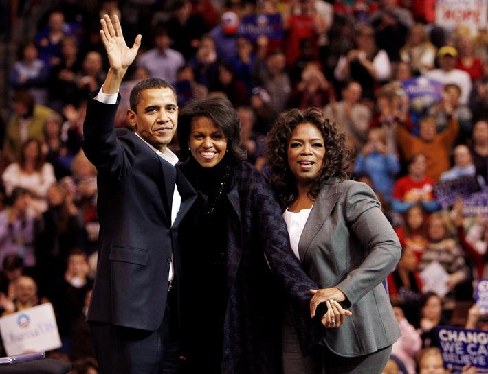 FILE PHOTO: Democratic presidential candidate U.S. Senator Obama his wife Michelle and entertainer a