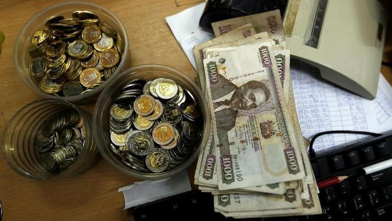 Kenya Shilling Coins And Notes Are Pictured Inside A Cashier S Booth At Forex Exchange Bureau