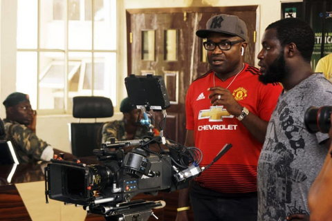 Obi Emelonye on the set of 'Badamasi' [Instagram/@obiemelonye]