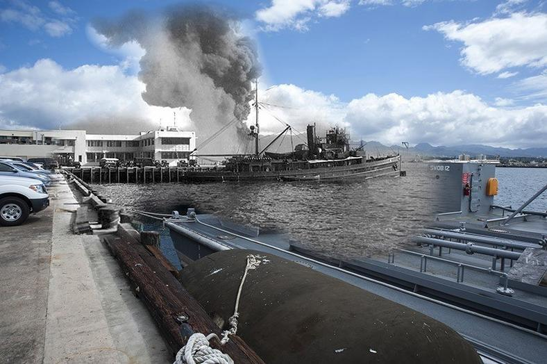 The battleship USS Arizona burns during the attack, as viewed from Ford Island.