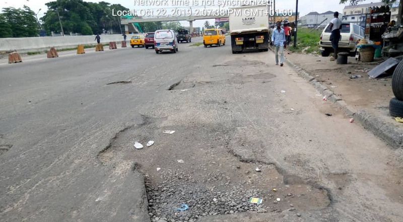 "Infrastructure: Lagos APC tweets image of ""fixed"" portion of Apapa-Oshodi expressway that leaves a lot to be desired"