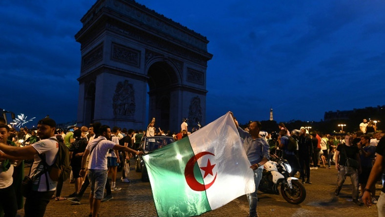 Several thousand people gathered at the Champs-Elysees in the French capital after Algeria's victory against Ivory Coast