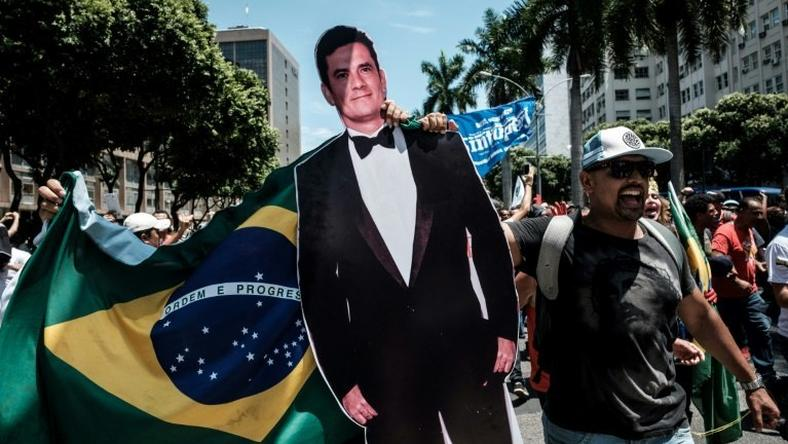 A protester carries a life-size image of Brazilian Federal Judge Sergio Moro, who conducts the Lava Jato probe, the biggest corruption investigation in the nation's history, during a public servants' demo in Rio de Janeiro, on December 12, 2016