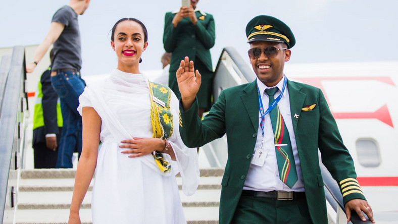 Ethiopian Airlines pilot (right) and an air hostess disembark from the inaugural flight into Victoria-Falls.