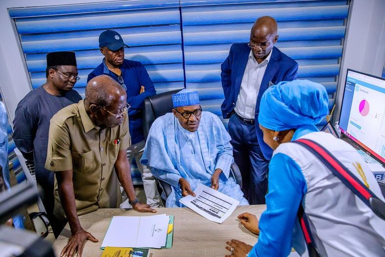 President Buhari pays surprise visit to the APC Situation Room during the just ended presidential election (APC media)