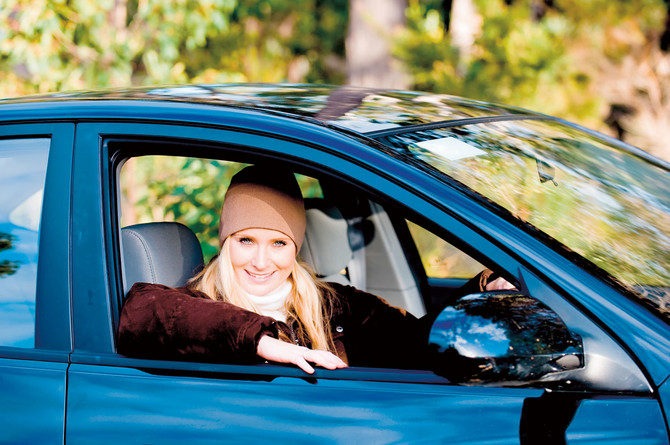12185_stock-photo-a-young-woman-sitting-in-drivers-seat-of-a-saloon-car-shutterstock_13325971