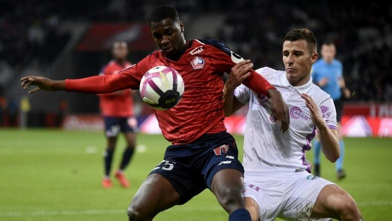 Fode Ballo-Toure (L) in action for Lille last month -- he has joined Monaco on a four-and-a-half-year deal