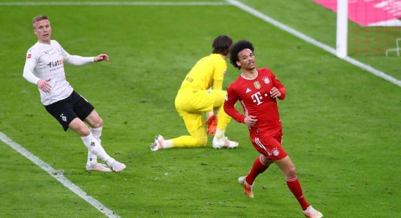 Leroy Sane (R) celebrates scoring Bayern Munich's final goal in a 6-0 thrashing of Moenchengladbach Creator: MATTHIAS SCHRADER