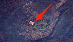 Lava flows surrounded a house following the eruption of a volcano in the Cumbre Vieja national park at El Paso, on the Canary Island of La Palma, Spain September 23, 2021.