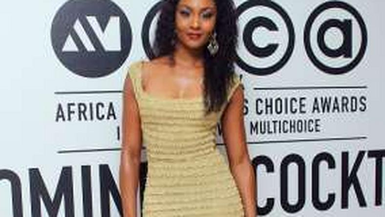Osas Ighodaro in a form fitting Iamisigo piece
