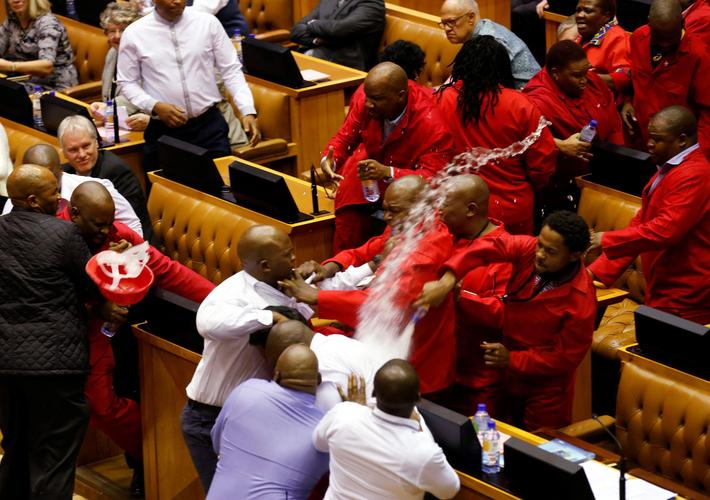 Party leader Julius Malema and members of his Economic Freedom Fighters (EFF) clash with Parliamenta