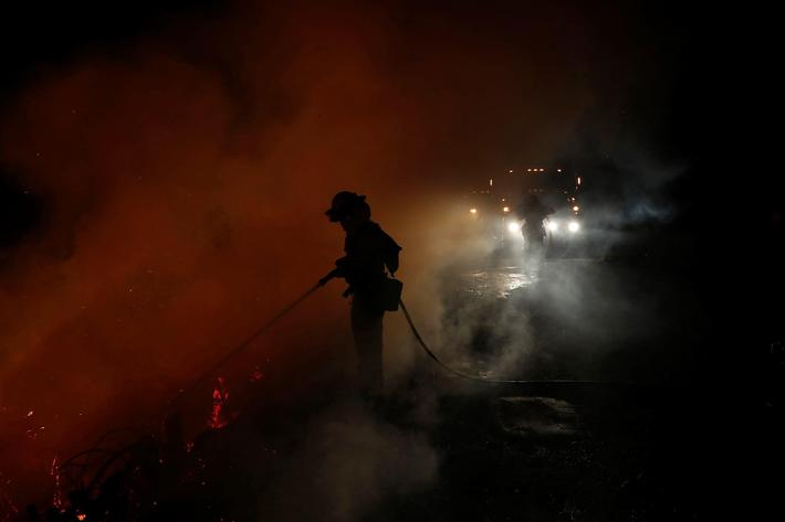 Firefighters battle the Loma Fire near Santa Cruz, California