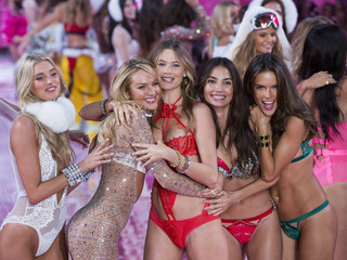 Models Martha Hunt, Candice Swanepoel, Behati Prinsloo, Lily Aldridge and Alessandra Ambrosio celebrate after presenting creations from the 2015 Victoria's Secret Fashion Show in New York
