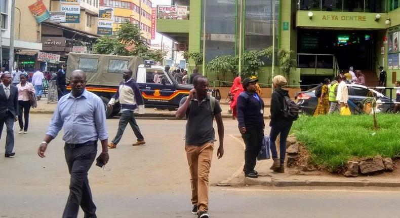 Police land rover at Afya Centre keeping away matatus from entering the CBD