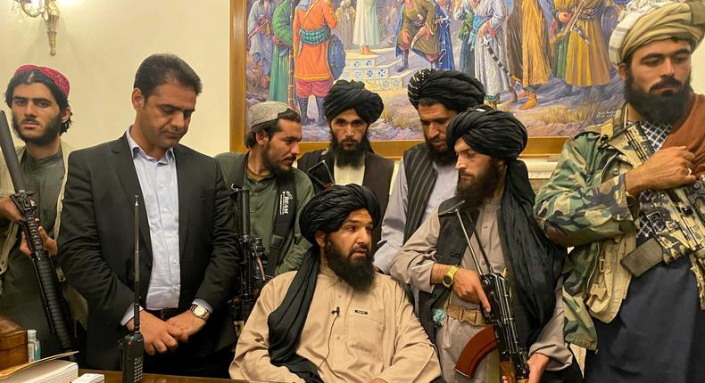 Taliban fighters in the Afghan presidential palace, Kabul, after President Ashraf Ghani fled the country.